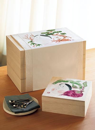おかめの絵が描かれた熨斗紙を掛けた三段重